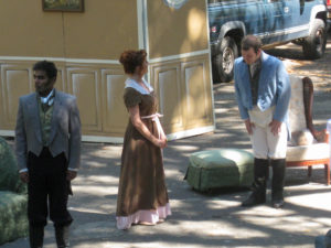 Mr. Darcy, Jane Bennett and Mr. Bingley.  (Outdoor theater often means trucks nearby!)